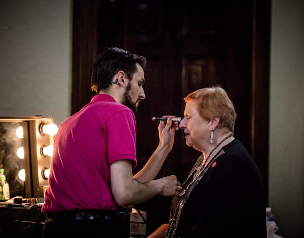 Heather Birch gets her make up touched up. Photo by Bryony Jackson.