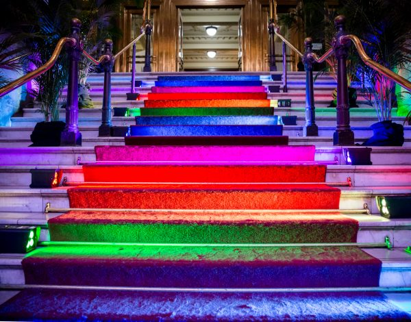The rainbow staircase entrance to The Coming Back Out Ball. Photo by Bryony Jackson.